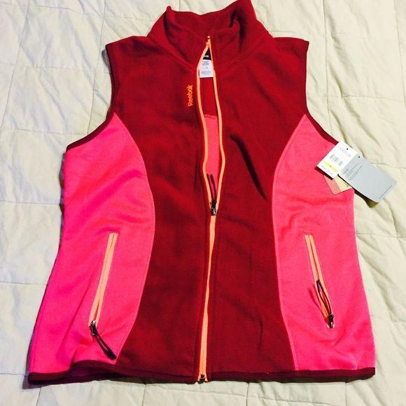 Reebok fleece sport vest Reebok sport performance fleece zip up vest with two front zip up pockets. Classic cut. Polyester and spandex. Machine washable.  No trades Reebok Jackets & Coats Vests