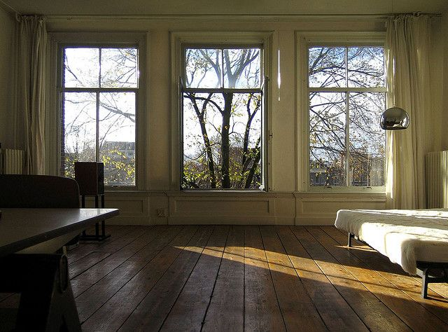 Love the big windows and wooden floors.