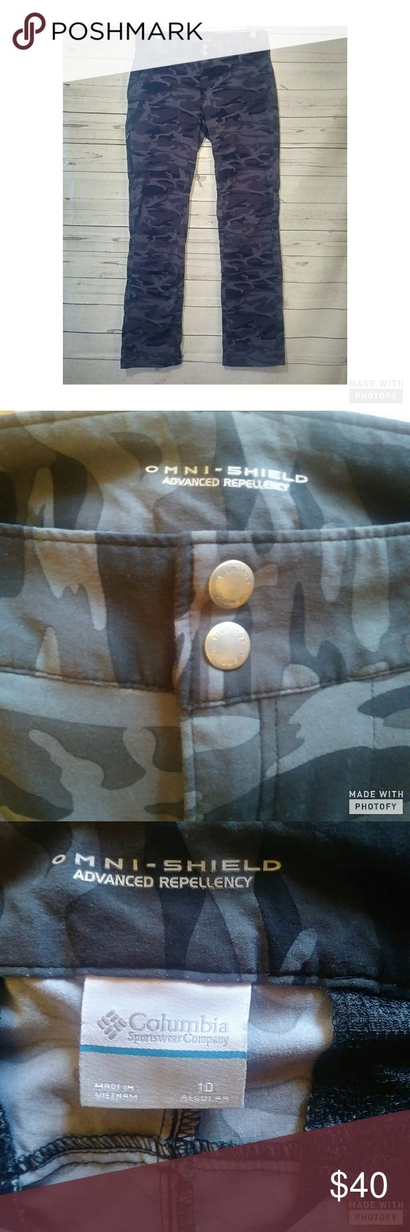 """Columbia sports Omni-Shield black camo pants(8) Like new. Only washed 1 time. These are a black camo hiking pant. Its  the advanced repellancy hiking pant. Has buttons on inside mid cuff to raise pant leg up.  Measurements laying flat Inseam 30"""" 16""""across These are size 10 however I personally think they run small. Use measurements Columbia Pants Boot Cut & Flare"""