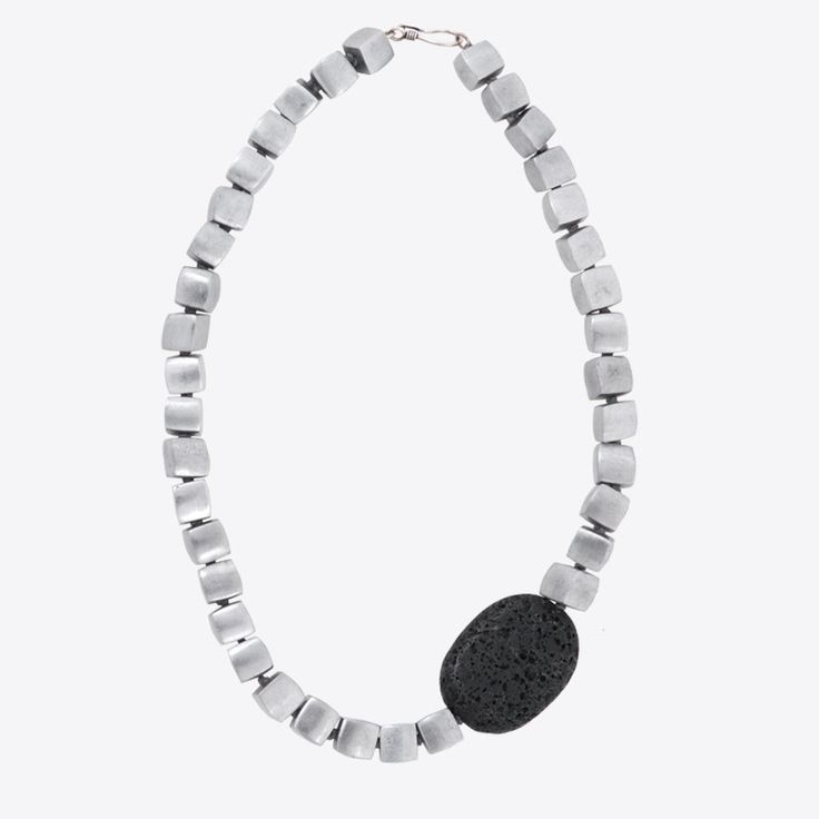 cubes & lava necklace | xombli design e-shop Necklace with large cubic aluminum beads, lava rock and a silver clasp. The luminous shades of grey in a game between light and shade by internationally acclaimed Greek designer Elena Votsi who always finds inspiration in her birthplace, the island of Hydra.