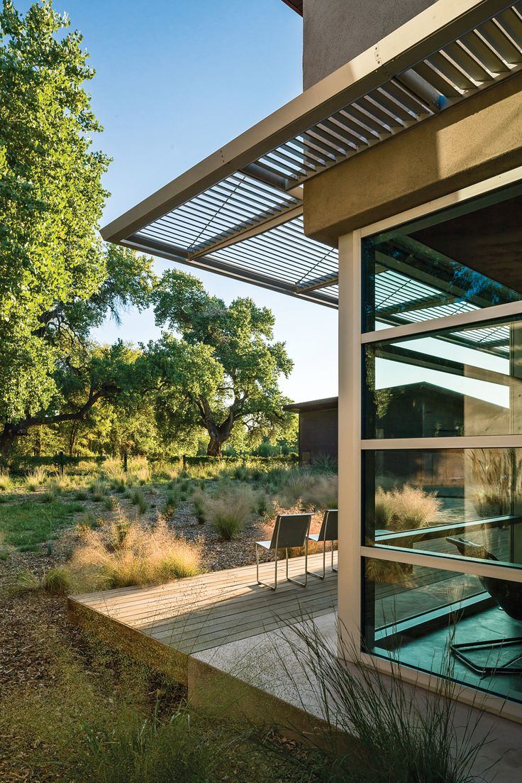 Glass and cement deck ○ Eco friendly rammed-earth home New Mexico