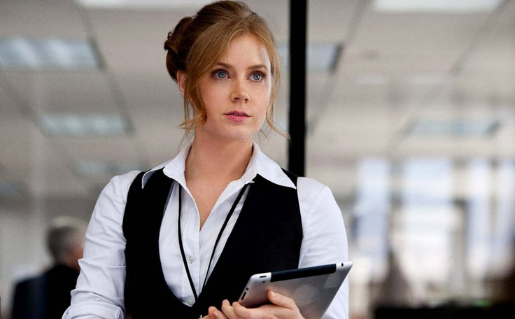 Lois Lane, the DP's star reporter. She's almost indifferent to Clark Kent at this point, and she's too busy to bother with the new intern.