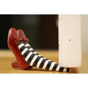17 best images about fun ideas gifts on pinterest wicked witch bottle holders and wine glass - Wizard of oz doorstop ...