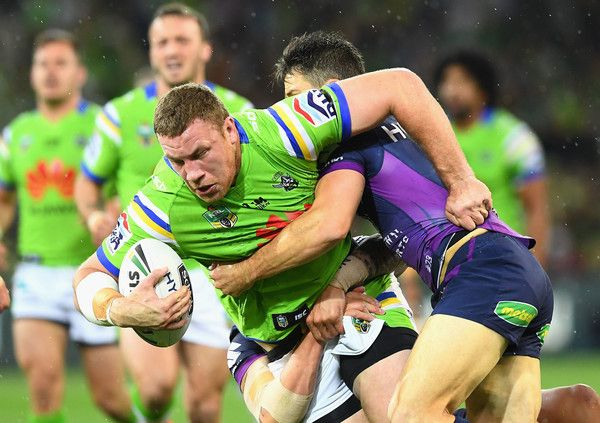 Shannon Boyd of the Raiders is tackled by Cooper Cronk of the Storm  during the NRL Preliminary Final match between the Melbourne Storm and the Canberra Raiders at AAMI Park on September 24, 2016 in Melbourne, Australia.