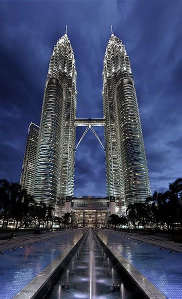Petronas Towers - twin skyscrapers in Kuala Lumpur, Malaysia. According to the CTBUH's official definition and ranking, they were the tallest buildings in the world from 1998 to 2004 until surpassed by Taipei 101, but remain the tallest twin buildings ever built, surpassing the World Trade Center. The building is the landmark of Kuala Lumpur with nearby Kuala Lumpur Tower.
