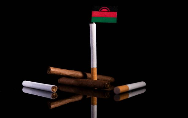 malawi flag with cigarettes and cigars tobacco industry concept