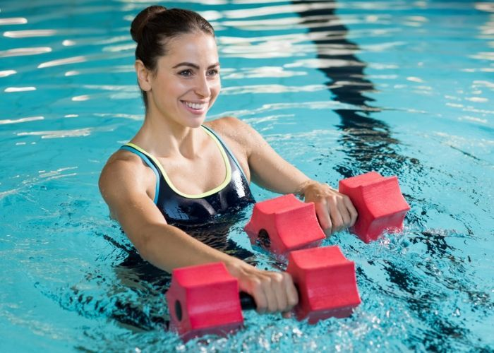 Beginners Guide To Water Aerobics Classes Exercises Aquatic Therapy Aerobics Water Aerobics
