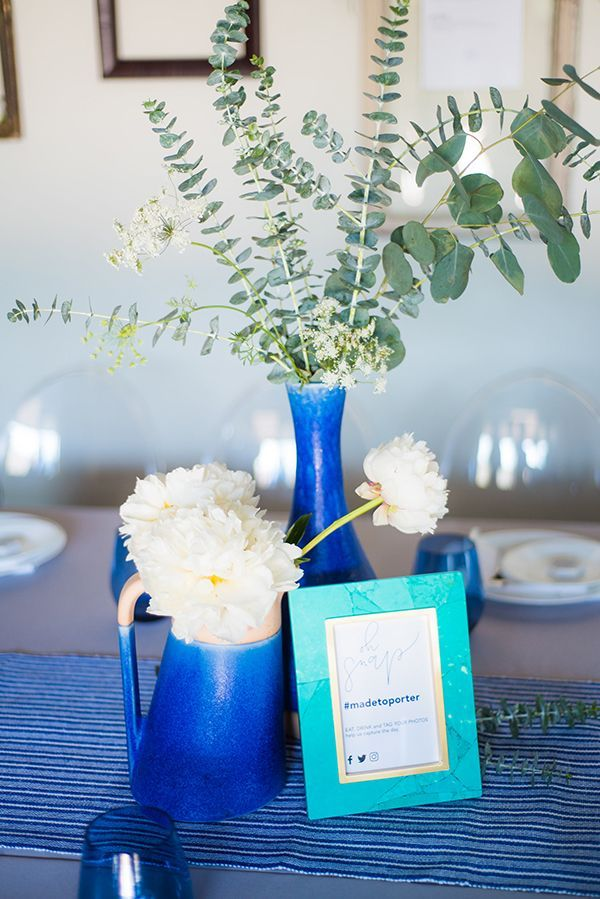 Eucalyptus and white peonies in blue vessels | Photo by Kera Photography