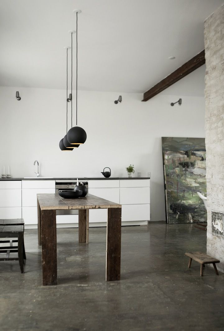 Really liking the touches of black with such a high ceiling and raw concrete feel flooring
