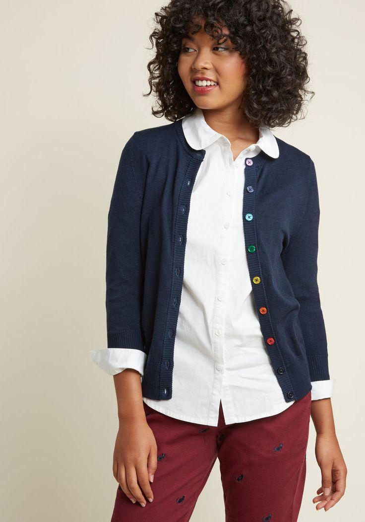 <p>Show your style smarts in this navy cardigan! With a rainbow-buttoned front, 3/4-length sleeves, and a fine, soft knit with ribbed edges, this versatile sweater will be your favorite wardrobe staple. No matter how you wear it, this ModCloth-exclusive piece offers an A+ look. By the way, this lovely item will be available for purchase in August!</p>