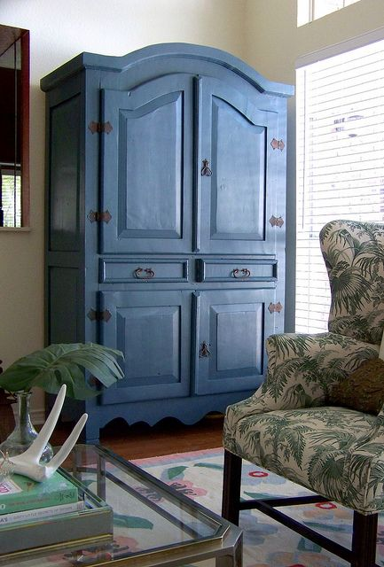blue living room armoire and green chair