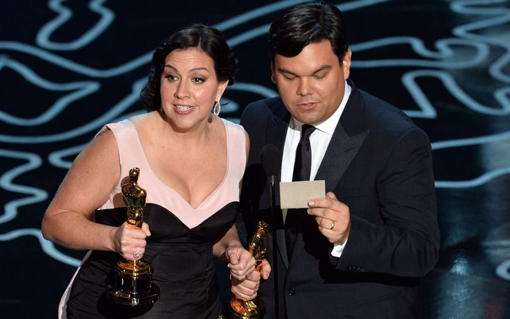 Songwriters Kristen Anderson-Lopez (L) and Robert Lopez accept the Best Achievement in Music Written for Motion Pictures, Original Song award for 'Let It Go' from 'Frozen'.