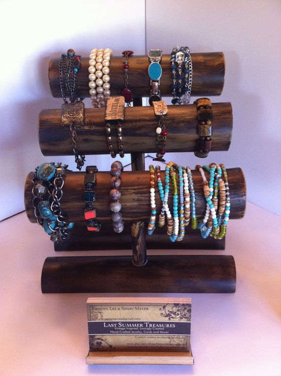 Bamboo Bracelet Display.  Two Color/Finish Options: Burnt Wood (Dark) or Natural Wood (Light).  Customized height and circumference. on Etsy, $15.00