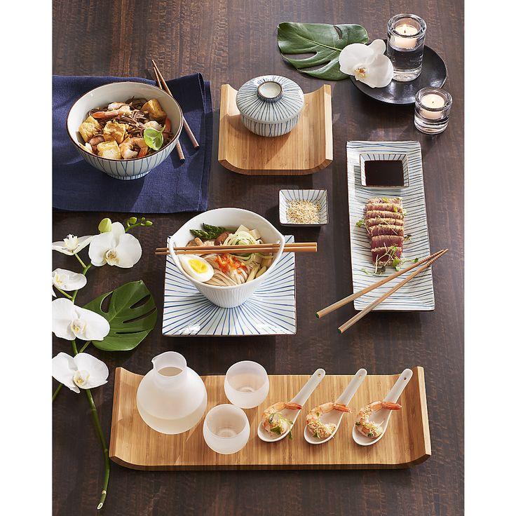 Shop Kai Noodle Soup Bowl. Modern Asian serving shape in white porcelain rests bamboo chopsticks in the cutout handles.