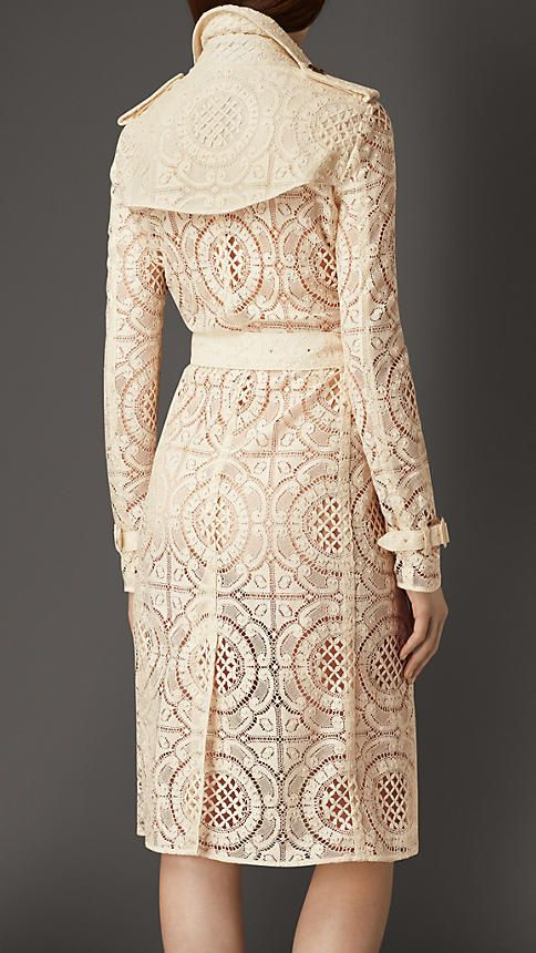 Burberry Parchment Floral English Lace Trench Coat - A trench coat crafted in English-woven lace. The closely cut trench features set-in sleeves, a belted waist and double-breasted button closure.