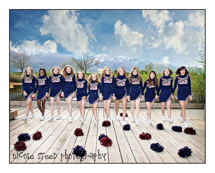 great way to get a larger group shot. (plus I love the idea of the poms on the ground...just think it could be bouquets if it were a wedding party)