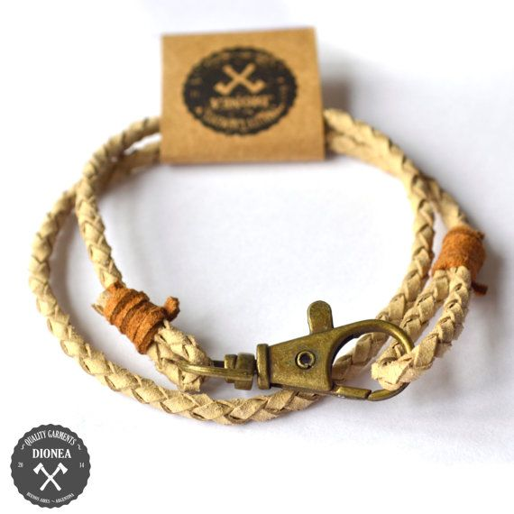 Braided leather bracelet with brass closure