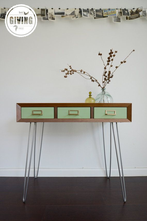 Functional and beautiful, this handcrafted console table features solid black walnut wood, mint green vintage metal drawers and steel hairpin legs. Perfect for an entryway or behind a sofa, the timeless design and impeccable construction of this piece makes it something that can be passed down from generation to generation.