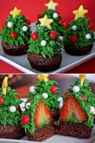 Christmas tree cupcakes w/ strawberries covered in icing. I wouldn't mind trying this.
