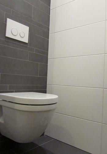 Zwevend toilet, inbouwreservoir, tegelwerk en design toiletmeubel.
