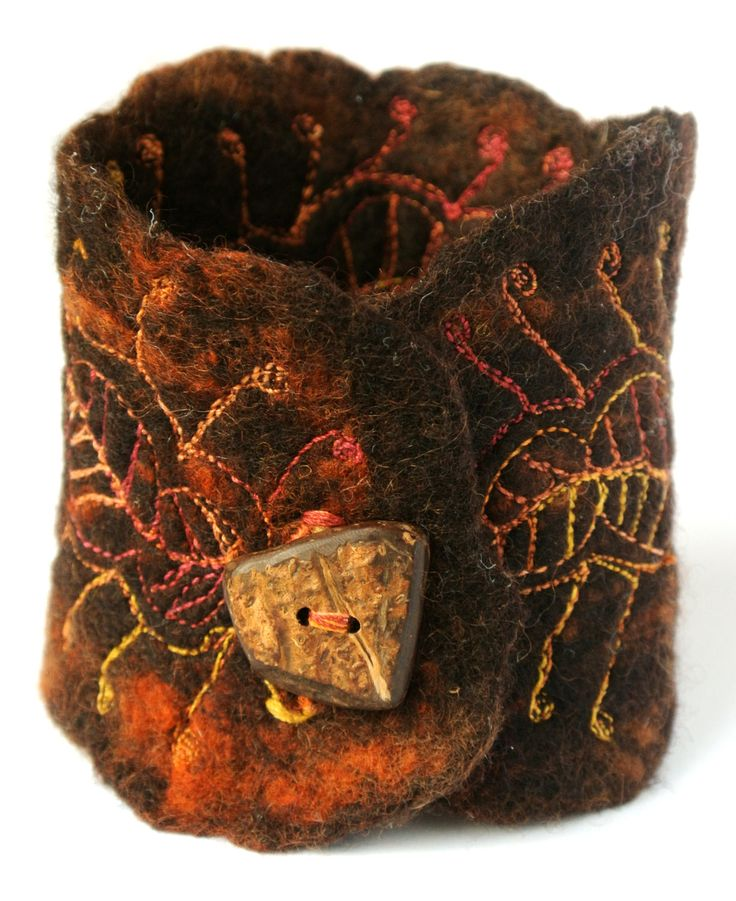 Ohhhhh love this. Henna - wet felted cuff with handmade button. £15.00, via Etsy.