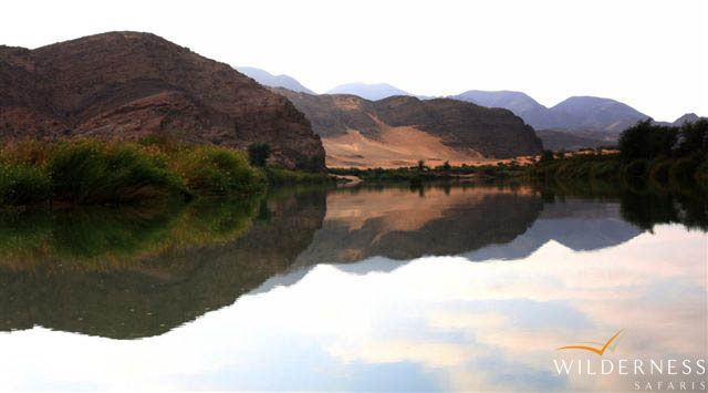 River reflections along the Kunene. #Safari #Africa #Namibia #WildernessSafaris