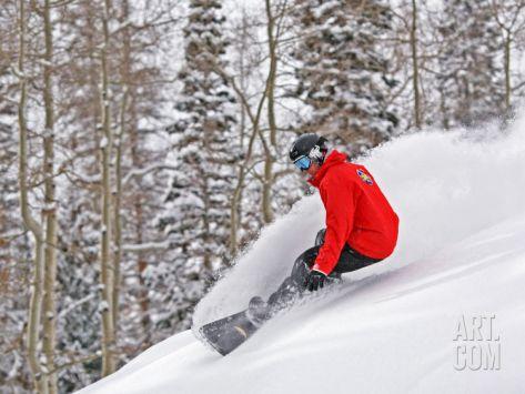 Snowboarder Enjoying Deep Fresh Powder at Brighton Ski Resort Photographic Print by Paul Kennedy at Art.com