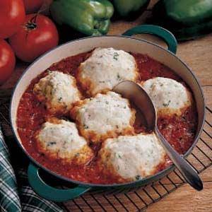 The wonderful fresh tomato taste of the sauce complements these light savory dumplings. They make a perfect side dish for a meal with beef. My family enjoys them very much.