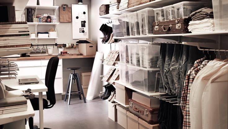 Perhaps our shipping room. A back office with desk, storage and wall shelves with transparent boxes