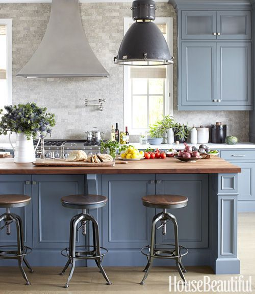 beautiful masculine kitchen by Parrish Chilcoat & Joe Lucas featured in House Beautiful. Love the two tones of gray from Farrow & Ball's Down Pipe, to Benjamin Moore's Chelsea gray on the island. The vintage stools, industrial pendant fixture, and the acid washed seagrass limestone backsplash are simply gorgeous!