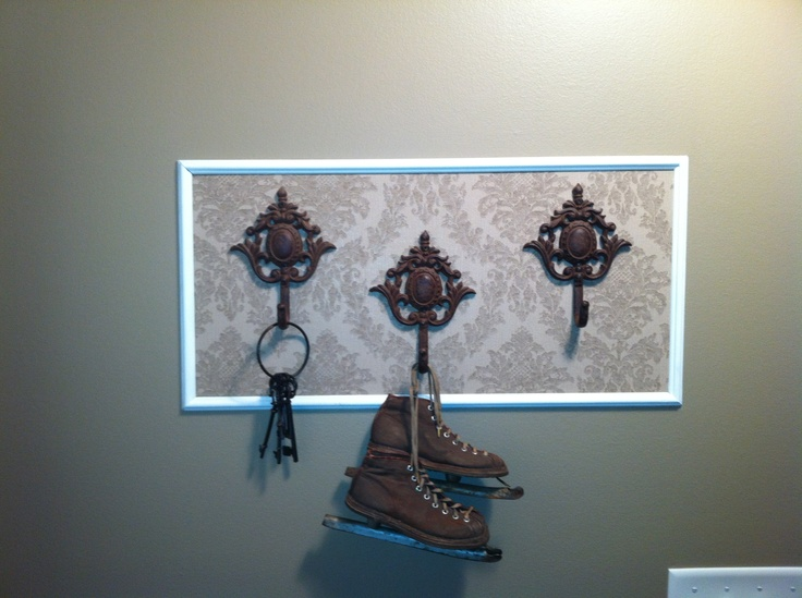Create a coat hook area with your favorite wallpaper, add trim.