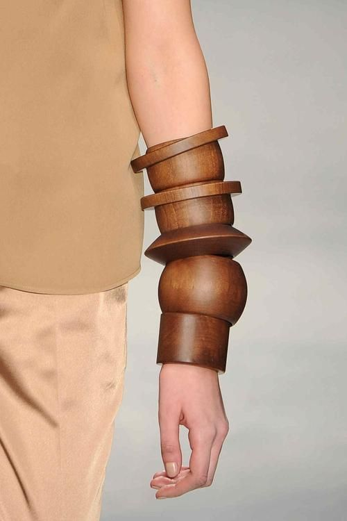 Chunky wooden bangles hint at tribal influences at #VeroniqueBranquinho #PFW