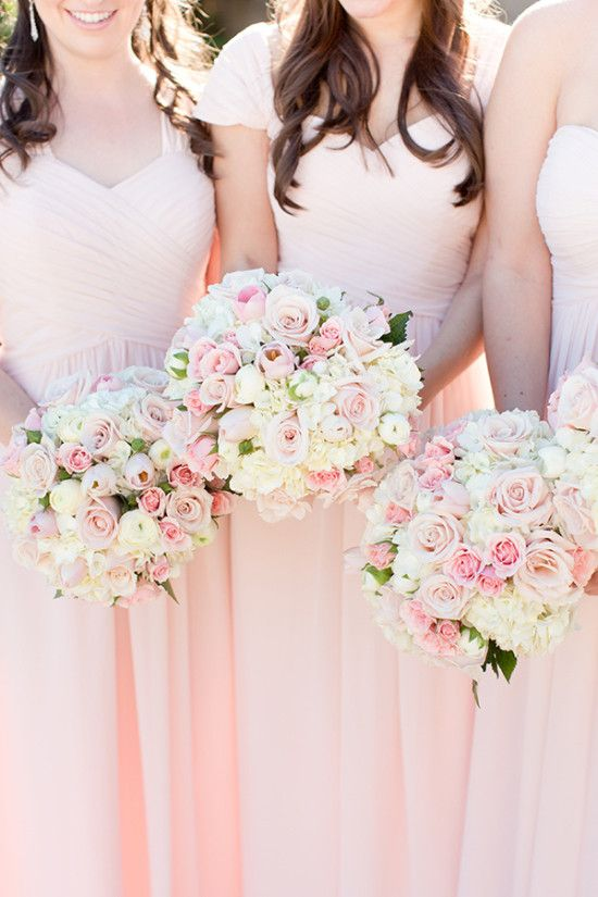 Bridesmaid bouquets in pink and white                                                                                                                                                      More