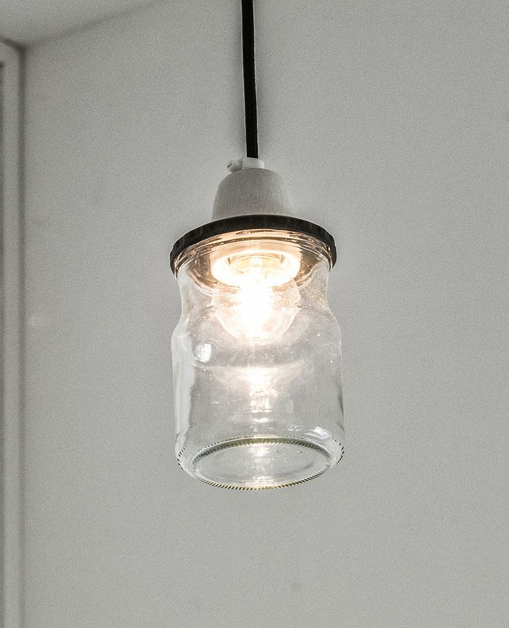 Interior Design Details - Industrial Close Ups | This small pendant light, made from a glass jar and a concrete top, brightens the space and contributes to an overall industrial vibe.