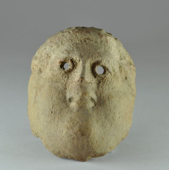Phoenician pottery mask, 1st millenium B.C. Punic pottery mask showing head of bearded man, 11.3 cm high. Private collection