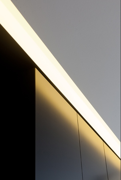 Lighting detail inside an apartment in  Brussels by architect Filip Deslee _