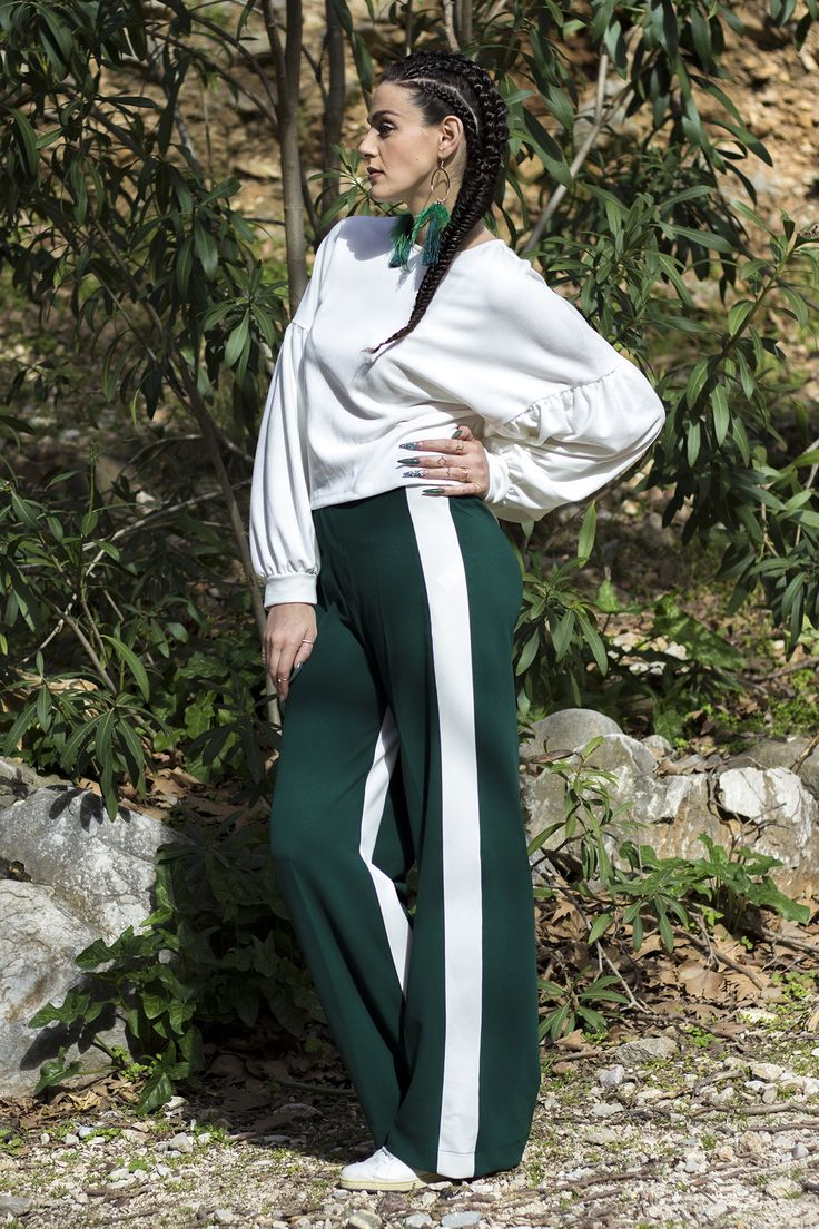 Sporty chic style. Boxer braids, balloon sleeves blouse, green side stripe pants, white sneakers and boho earrings.
