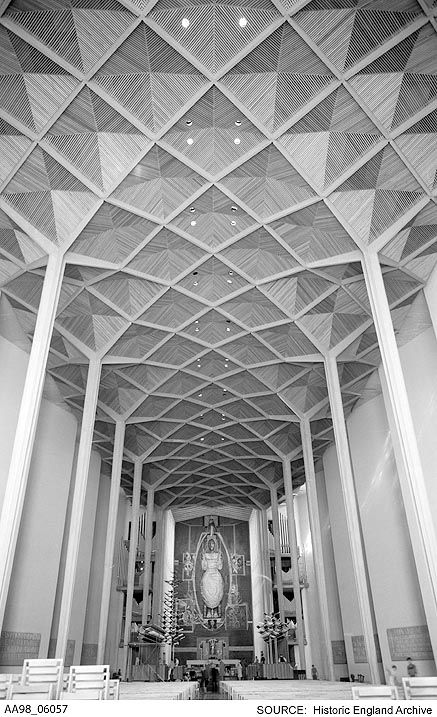 AA98/06057 Interior view of the post war cathedral looking towards the tapestry altarpiece designed by Graham Sutherland and showing roof details in the nave.  Coventry Cathedral, Priory Street, Coventry,    Date1962 - 1980 Photographer: Eric De Mare