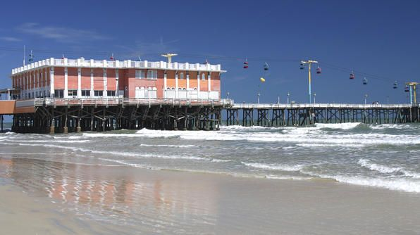 """Where to Go: Main Street PierCalled Daytona's """"highway over the ocean,"""" the 70 plus-year-old pier is the longest on the East Coast. It has rides such as a sky lift and space needle observation tower, a restaurant and a place for fishing."""