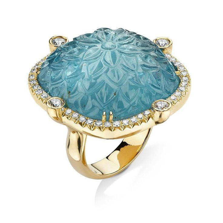 Aquamarine. Love this carved piece!