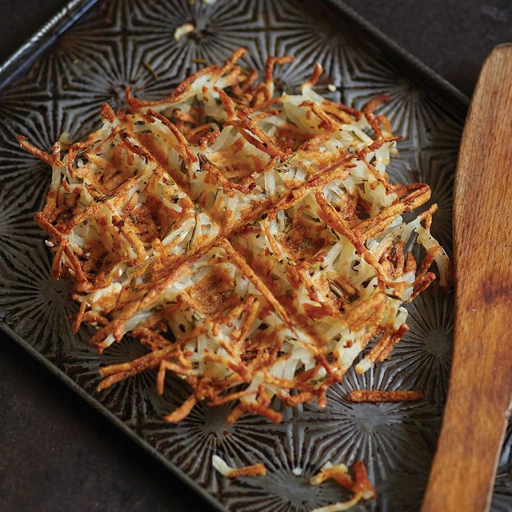 Waffled Hash Browns with Rosemary  Ingredients: Ingredients:  1 russet (baking) potato, about 10 ounces, peeled and shredded ½ teaspoon finely chopped fresh rosemary or 1 teaspoon dried rosemary ¼ teaspoon salt ½ teaspoon freshly ground black pepper 1 teaspoon unsalted butter, melted Grated cheese, sour cream, or ketchup, for serving