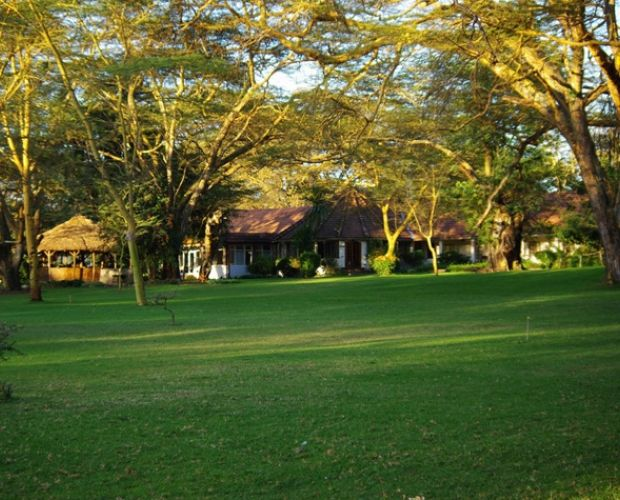 Lake Naivasha Country Club - The Club became famous in the 1930's as a staging post for Imperial Airways' flying boat service from Durban to London. The Old Colonial architecture is solid and comfortable with accommodation in rooms and cottage set in 12 hectares of green lawns shaded by mature acacias and spreading fever trees.
