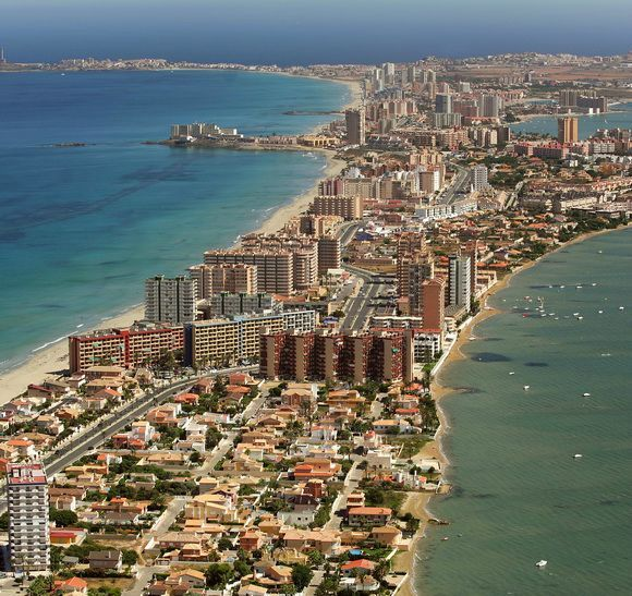 "La Manga or La Manga del Mar Menor (meaning ""The Sandbar of the Minor Sea"") is a seaside spit in the Region of Murcia, Spain. - http://www.theworldgeography.com/2013/07/incredible-spits.html"
