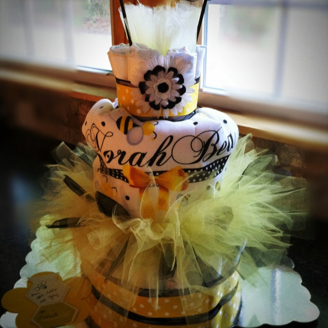 BaBEE diaper cake for a bee themed shower.  :) I am getting a lot better at my diaper cake abilities.  I hope you enjoy your gift Dana!
