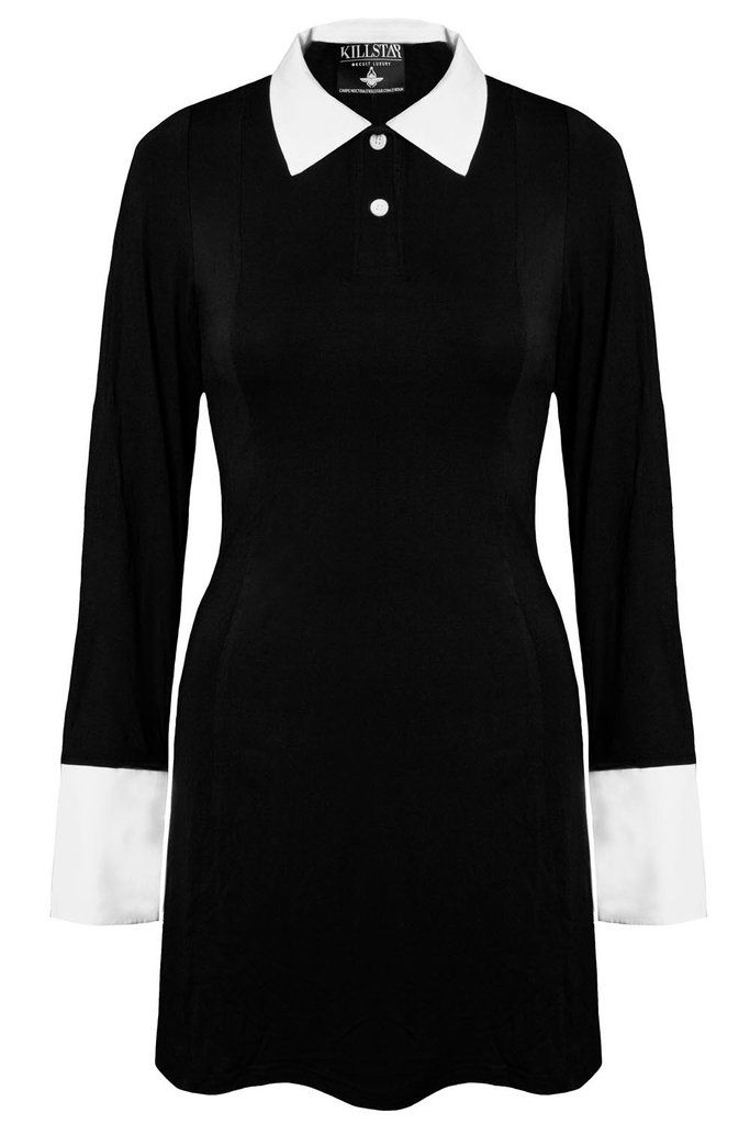 Channel Wednesday everyday of the week.. - Dress with Collar & Cuffs. - Soft Touch Jersey Fabric. - Zip Back. - Fitted. Long sleeved dress with button-up detailing, made in a super smooth black fabric