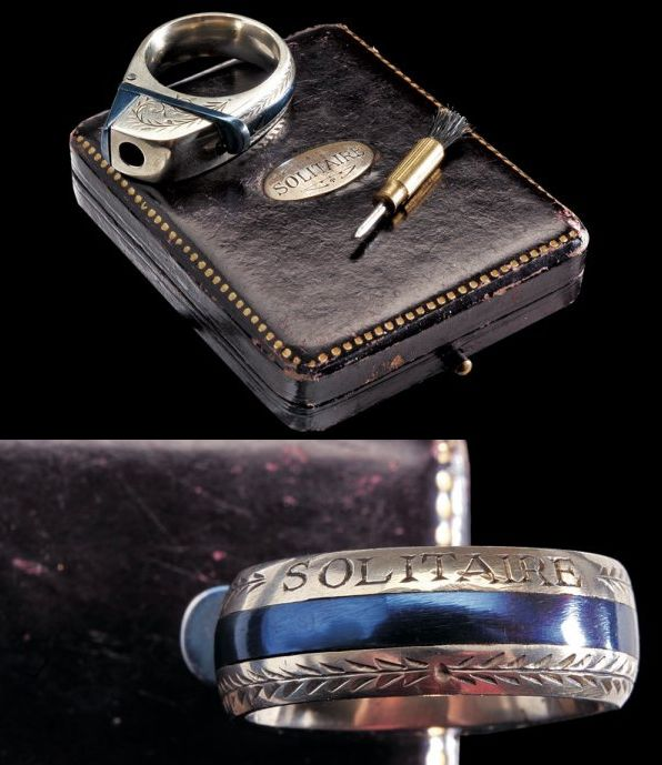 A ring pistol with case , France, late 19th century.