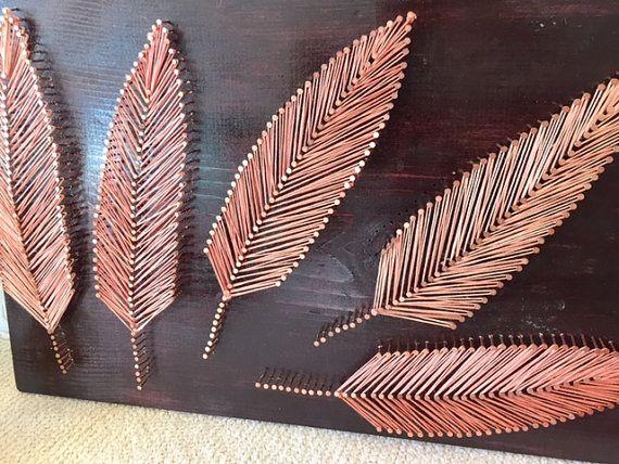 DIY - plumes ficelé avec de clous