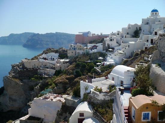 Greece: Famous Blue Domed church of Santorini (bottom right has orange house...)