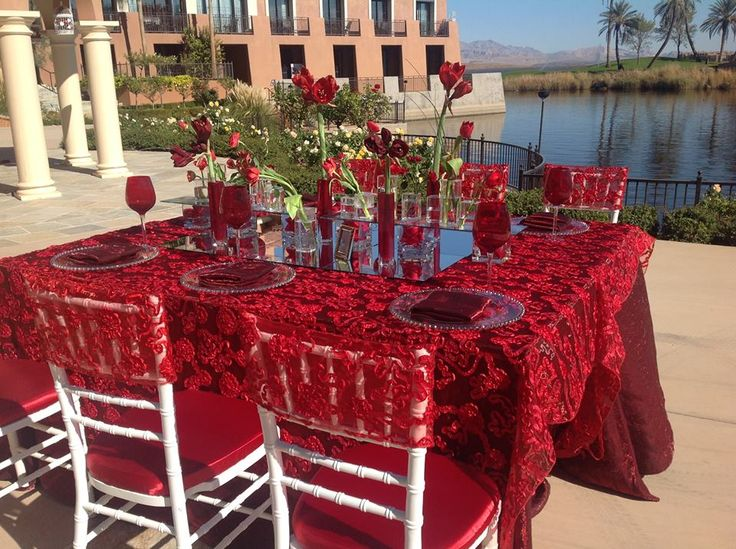Petals Flowers and Events was told to do a Wizard of Oz theme based on Dorothy's Ruby Red Slippers... We think they nailed it!! What a beautiful set up with the Brick crush and cherry luxury table linens. Creative Coverings Specialty Linen Rental and Sales