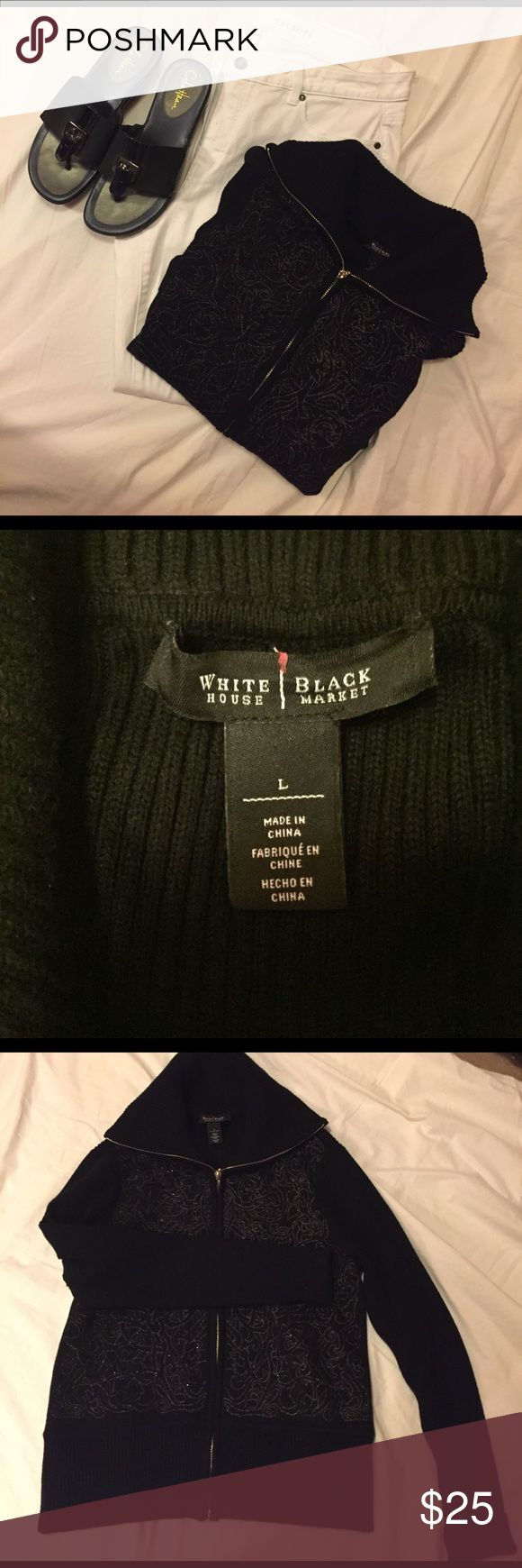 """White House/Black Market zip up sweater From White House/Black Market, womens size lg, in black w/gold embellishments on front & zips up. Has a collar and is absolutely gorgeous. Arms are cuffed, but don't have to be. Heavy material for a cold day, as it has 9% wool in it, but very comfy. All black (except where gold) is ribbed. Measures (laying flat) 18 1/2"""" across front underarms, 18"""" across bottom & 14"""" long from underarm to bottom. Has a lot of stretch though, so you can get 2"""" more…"""